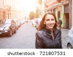young smiling woman walking on... | Shutterstock . vector #721807531