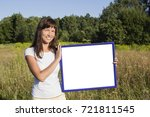 girl standing in field of... | Shutterstock . vector #721811545