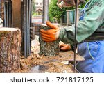 worker chopping firewood with a ... | Shutterstock . vector #721817125