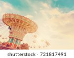 carousel ride spins fast in the ... | Shutterstock . vector #721817491