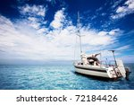 Yachting in gorgeous tropical waters - stock photo