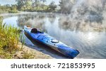 blue kayak anchored by river... | Shutterstock . vector #721853995