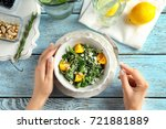woman eating superfood salad... | Shutterstock . vector #721881889