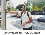 attractive young man wearing... | Shutterstock . vector #721904005