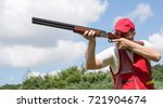 man shooting skeet with a... | Shutterstock . vector #721904674