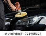 Car detailing series: Closeup of polishing black car - stock photo