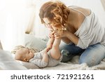 happy mother playing with...   Shutterstock . vector #721921261