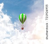 Small photo of Colorful aerostat flying over the blue cloudy sky. 3D rendering.