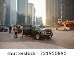 Small photo of Chicago, IL, Sept. 23, 2017: A young couple gets into a cab after exiting their hotel, downtown Chicago, in the Loop. Cabs are ubiquitous in Chicago, where millions of people visit each year.
