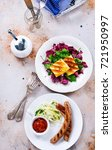 sausages and salad for the... | Shutterstock . vector #721950997