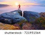 hiker on rock end above valley. ... | Shutterstock . vector #721951564