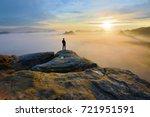 hiker on rock end above valley. ... | Shutterstock . vector #721951591