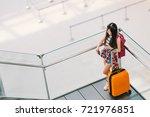 cute teenage asian traveler... | Shutterstock . vector #721976851
