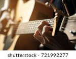 left hand and chord of guitar.   Shutterstock . vector #721992277