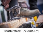 Wood Construction Power Tool. Wood Plank Cutting by Reciprocating Saw.  - stock photo