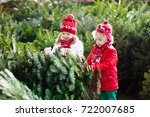 family selecting christmas tree.... | Shutterstock . vector #722007685