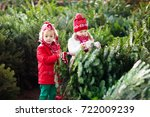 family selecting christmas tree.... | Shutterstock . vector #722009239