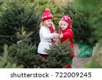 family selecting christmas tree.... | Shutterstock . vector #722009245