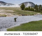 A Fly Fisherman Standing In The ...