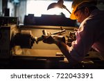 Small photo of Heavy industry manual asian worker with grinder, asian man wearing mask with his hands grinding in heavy industry