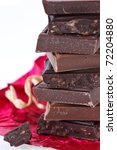 Pyramid dark and milk chocolate on a red foil. - stock photo