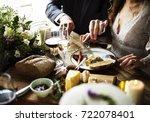 bride and groom having meal...   Shutterstock . vector #722078401