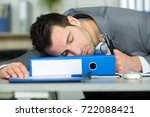 man napping on his desk | Shutterstock . vector #722088421