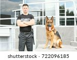 Security Guard With Dog Near...