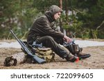 male hunter preparing food with ... | Shutterstock . vector #722099605