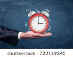 a male hand holds palm up a... | Shutterstock . vector #722119345