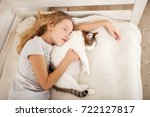 happy girl with pet at home.... | Shutterstock . vector #722127817