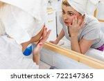 worried shocked woman looking... | Shutterstock . vector #722147365