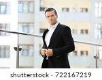 handsome man in elegant black... | Shutterstock . vector #722167219