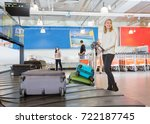 woman with trolley standing by... | Shutterstock . vector #722187745