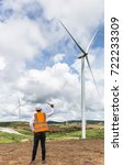 engineer in wind mill power... | Shutterstock . vector #722233309
