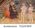 Small photo of SAN GIMIGNANO, ITALY - JULY 11, 2017: Renaissance Fresco (1365) by Bartolo di Fredi depicting Jesus, Adam and Eve in the Garden of Eden in the Collegiata of San Gimignano, Italy.
