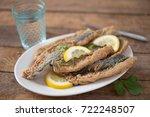 fried fish fillet with lemon... | Shutterstock . vector #722248507