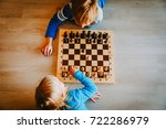 little boy and girl play chess | Shutterstock . vector #722286979