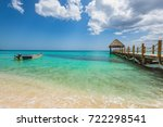 a motor boat in the sea near... | Shutterstock . vector #722298541