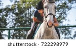 woman riding a horse on paddock ... | Shutterstock . vector #722298979