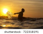 surfer waiting in the line up... | Shutterstock . vector #722318191