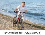 a fat man drives a bicycle... | Shutterstock . vector #722338975