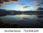 clouds at sunset reflected in...   Shutterstock . vector #722346169