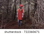 a scary evil clown wearing a... | Shutterstock . vector #722360671
