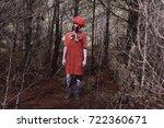 a scary evil clown wearing a... | Shutterstock . vector #722360671