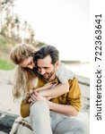 a young couple is hugging on... | Shutterstock . vector #722363641