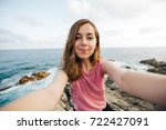pretty young woman doing selfie ... | Shutterstock . vector #722427091