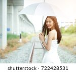Beautiful Woman Hold White...