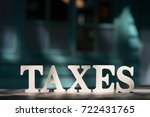 high angle view of  tax word on ... | Shutterstock . vector #722431765