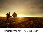 a young couple is traveling... | Shutterstock . vector #722433889